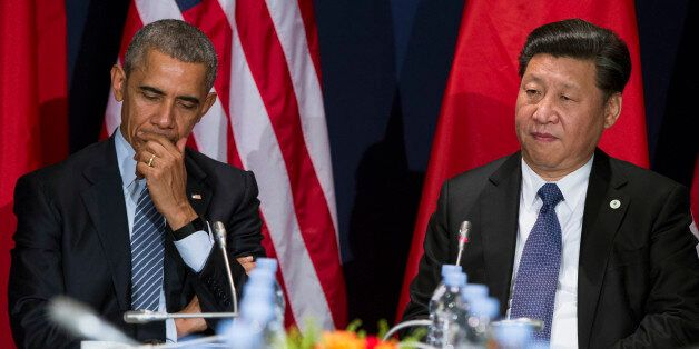 U.S. President Barack Obama, left, meets with Chinese President Xi Jinping during their meeting held on the sidelines of the