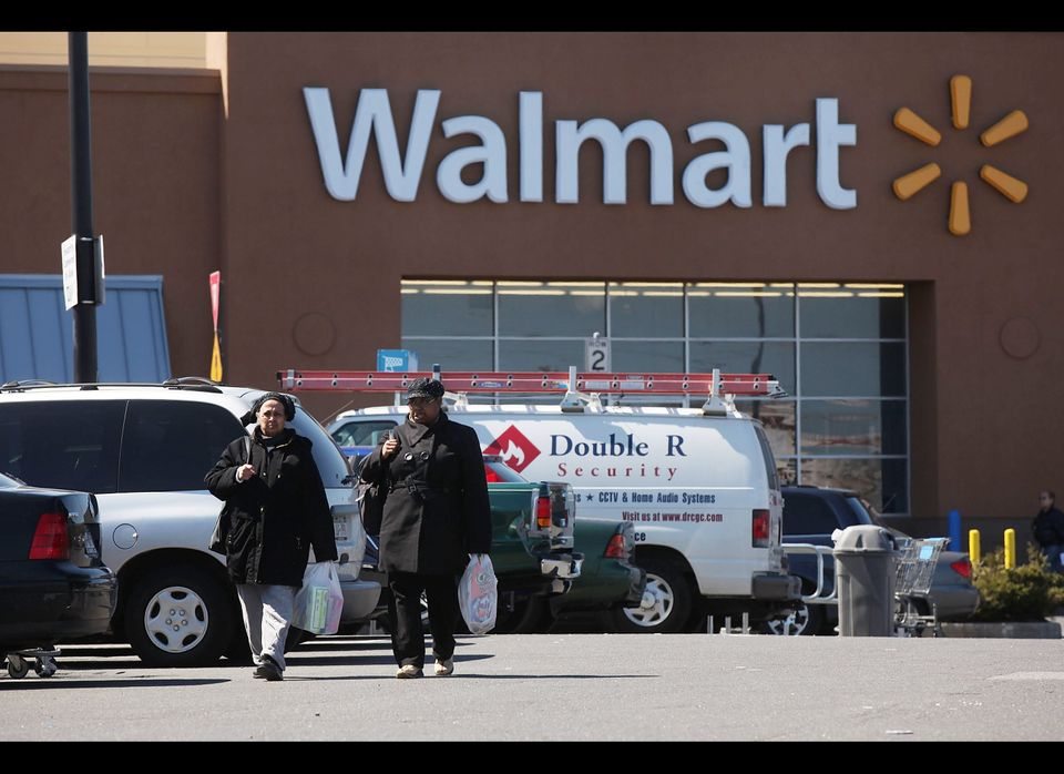 Shoppers exit a Walmart store on March 29, 2011 in Valley Stream, New York.