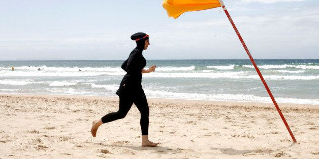 Twenty-year-old trainee volunteer surf life saver Mecca Laalaa runs along North Cronulla Beach in Sydney during her Bronze me