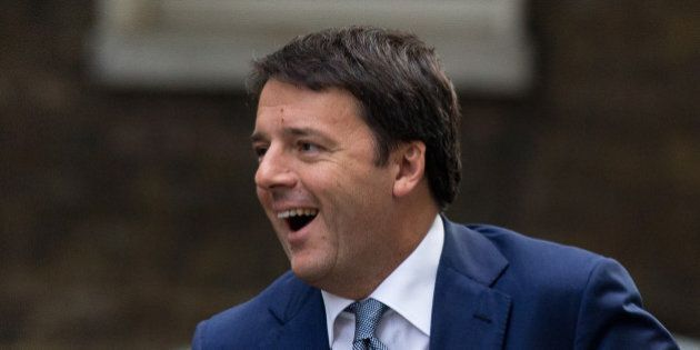 Italy's Prime Minister Matteo Renzi smiles upon seeing British Prime Minister David Cameron as he gets...