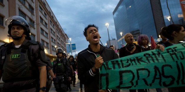 Students protest against the money spent on the Rio 2016 Olympics in Rio de Janeiro, Brazil, Sunday, Aug. 21, 2016. Demonstra