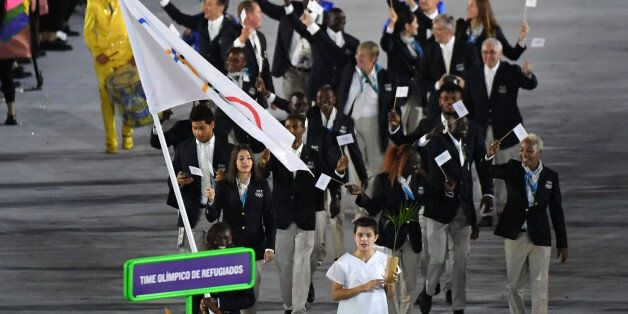 Refugee Olympic Team's Rose Nathike Lokonyen leads her delegation during the opening ceremony of the Rio 2016 Olympic Games a