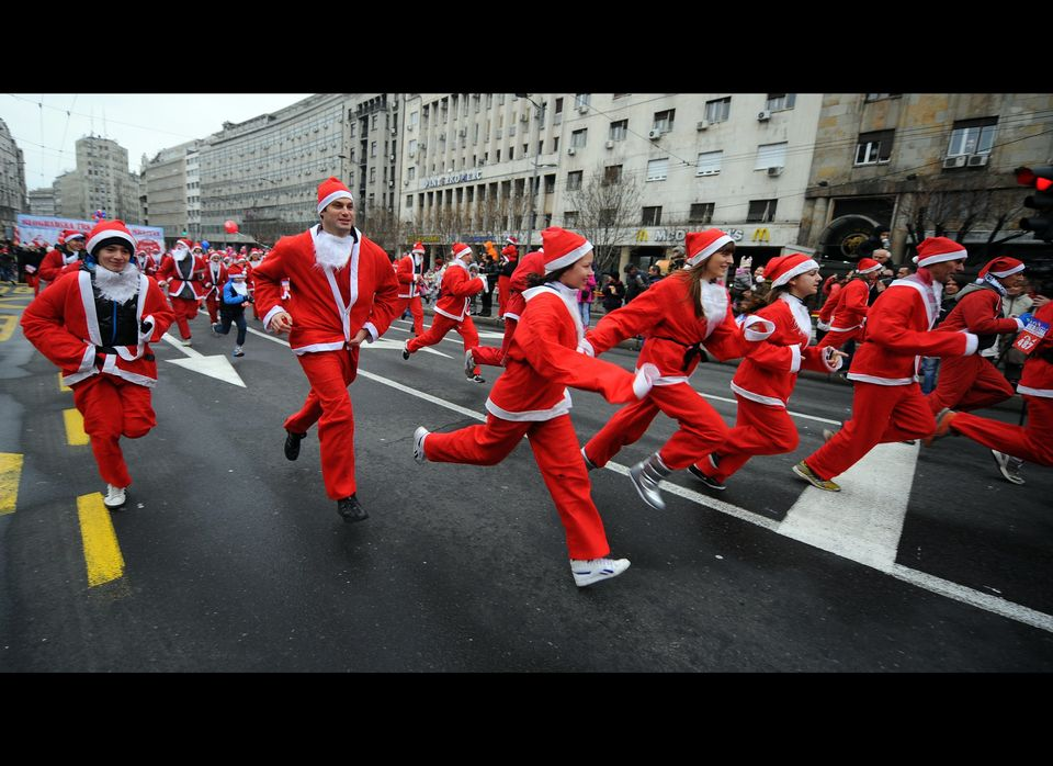 People dressed as Santa Claus take part in the traditional Christmas race in downtown Belgrade on December 25, 2011.