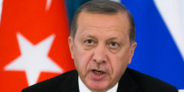 Turkish President Recep Tayyip Erdogan speaks at a news conference after his talks with Russian President Vladimir Putin in t
