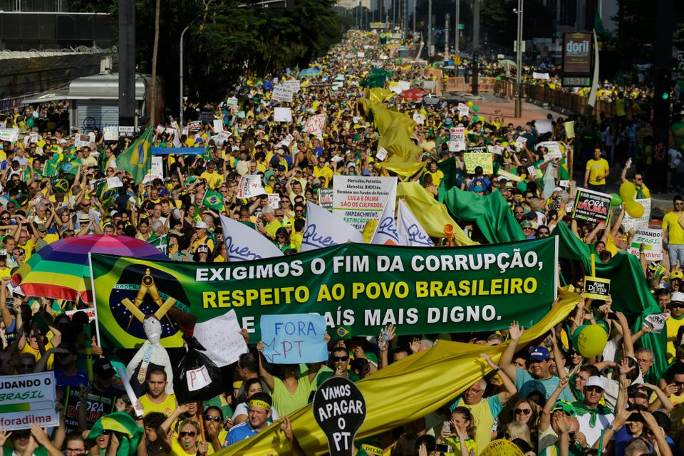 Thousands of demonstrators take part in anti-government protest in Sao Paulo, Brazil, Sunday, April 12, 2015. (AP Photo/Nelso