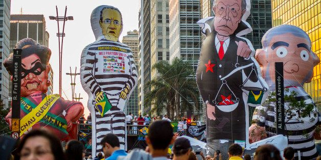 BRAZIL, Sao Paulo : Activists protest against suspended president Dilma Rousseff in Sao Paulo, Brazil on July 31, 2016.Protes