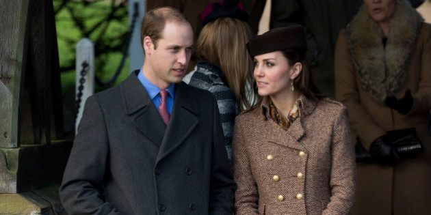 Britain's Prince William and his wife Kate Duchess of Cambridge leave after attending the British royal...