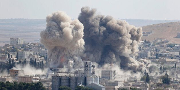 Smoke rises after an U.S.-led air strike in the Syrian town of Kobani Ocotber 8, 2014. U.S.-led air strikes on Wednesday push