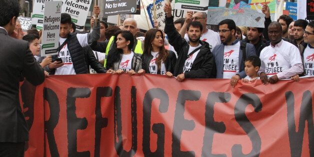 LONDON, UK - September 17: A group of refugees seen at the front line of the Refugees Welcome demonstration, as thousands