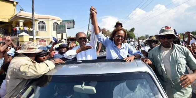 Presidential candidate Maryse Narcisse (C R) of the Fanmi Lavalas political party is joined by former Haitian President Jean-