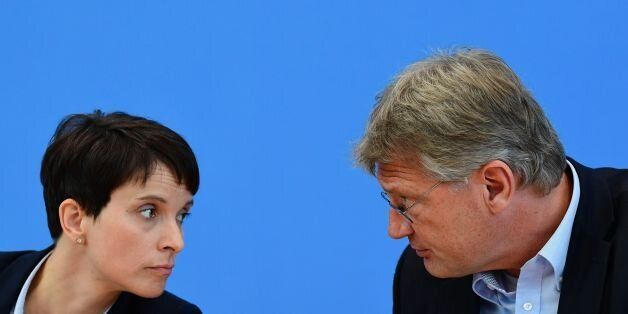 Leaders of the Alternative fuer Deutschland (AfD) Frauke Petry (L) and Joerg Meuthen attend a press conference one day after