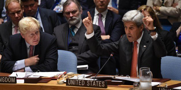 Boris Johnson(L), UK foreign secretary looks on as US Secretary of State John Kerry speaks during a Security Council Meeting