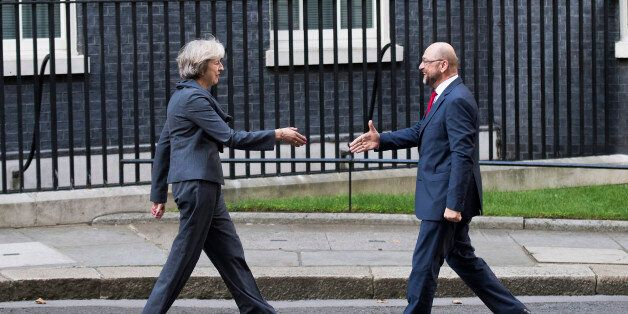 TOPSHOT - British Prime Minister Theresa May (L) greets President of the European Parliament Martin Schulz (R) outside 10 Dow