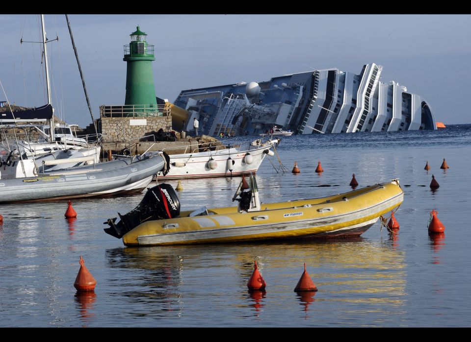 A view on January 19, 2012 of the cruise liner Costa Concordia aground in front of the harbour of the Isola del Giglio (Gigli