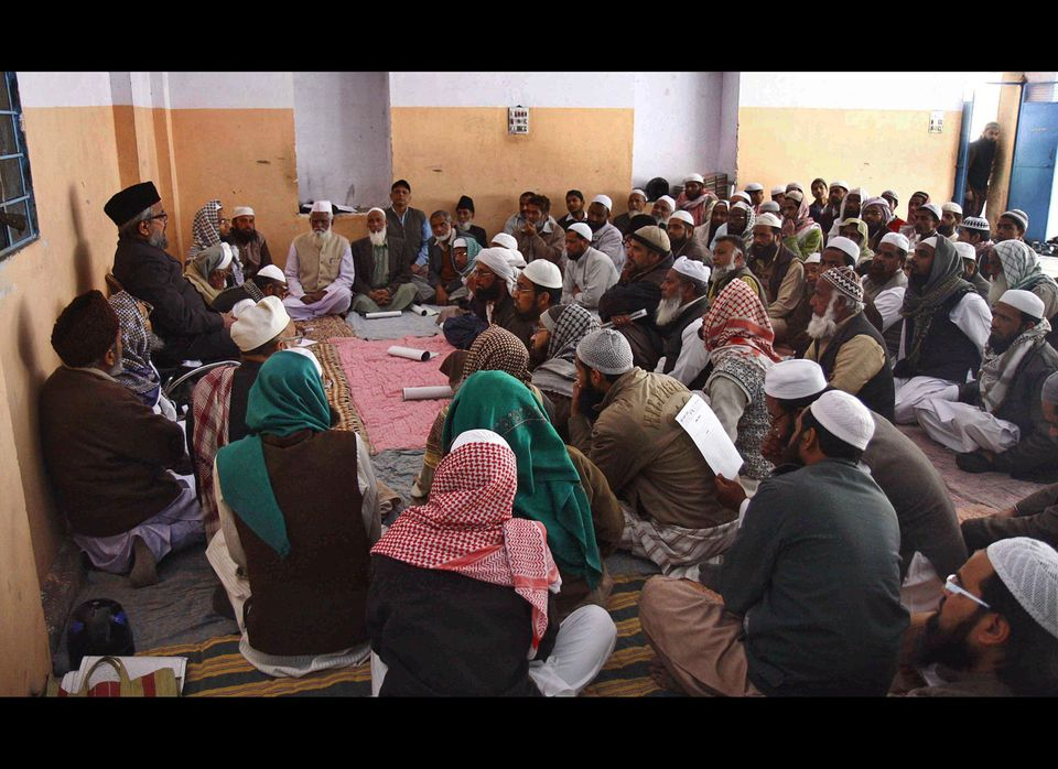 Members of Jamiat Ulama-E-Jaipur attend a meeting to pass a resolution requesting the state and central government not to all