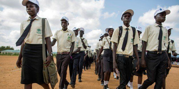Juba, SOUTH SUDAN: School girls and boys march to claim peace in the streets of Juba, South Sudan, on September 21, 2016.The