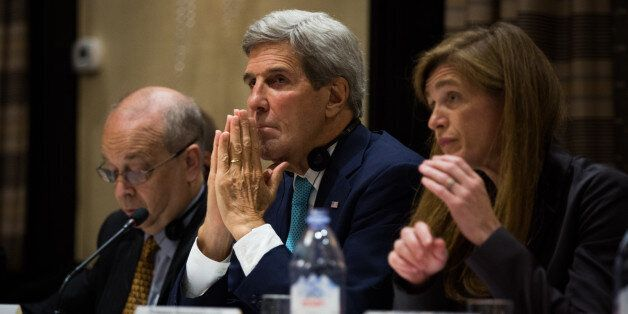 U.S. Secretary of State John Kerry listens during a trilateral meeting with the Republic of Korea and Japan Sunday, Sept. 18,