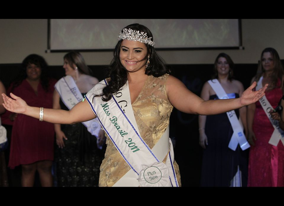 Contestant Barbara Monteiro, from Brazil's Mato Grosso do Sul state, gestures after winning the Miss Brazil Plus Size Beauty