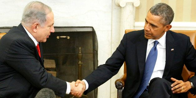 Israel's Prime Minister Benjamin Netanyahu (L) shakes hands with U.S. President Barack Obama as they sit down to meet in the
