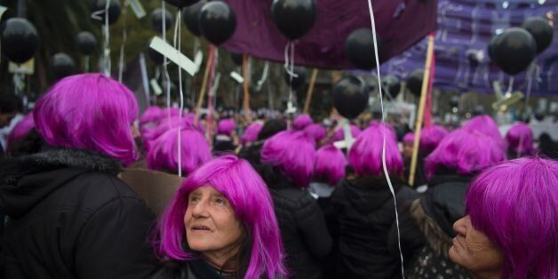 TOPSHOT - Women take part in the 'Ni una menos' (Not One Less) march against femicides in Buenos Aires, on June 3, 2016. / AF