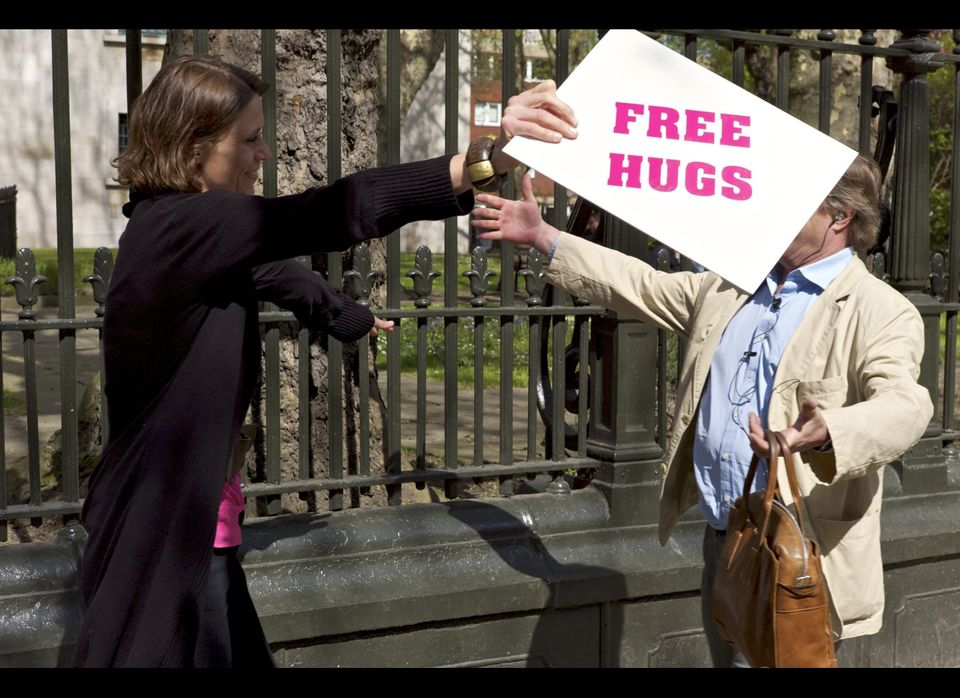 "The launch of ""Action For Happiness"" in London, Tuesday, April 12, 2011. Free hugs are given away to passers-by Maren Groteme"