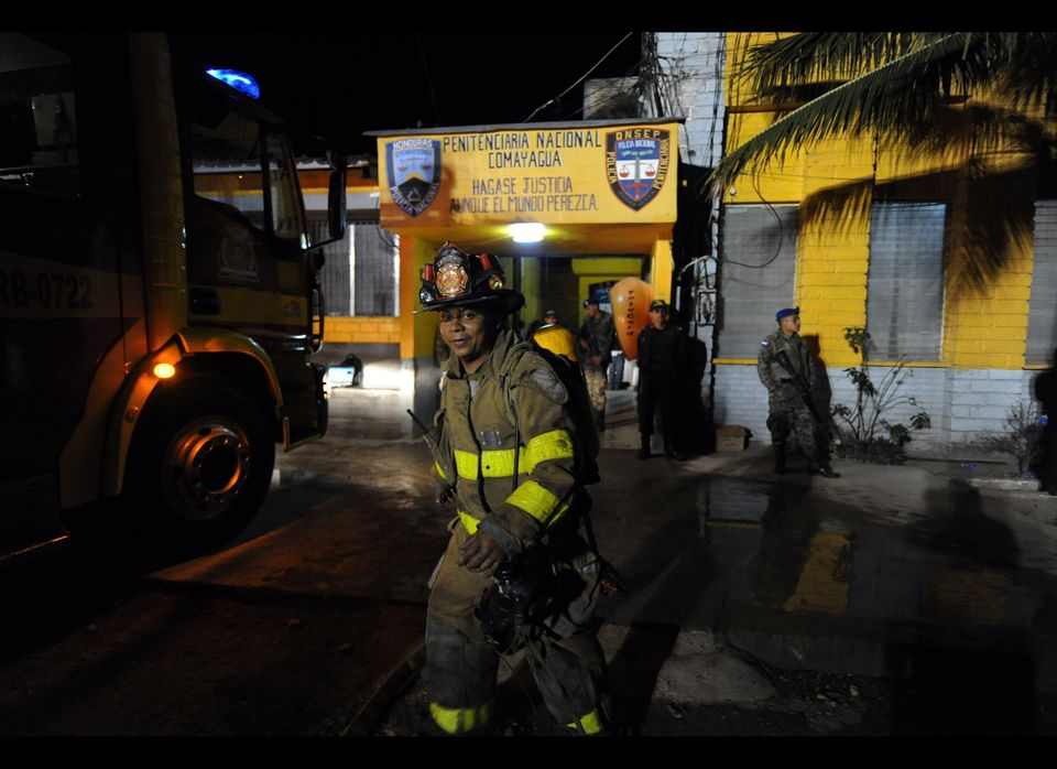 Firemen enter the National Prison of Comayagua where a fire broke out at the facility in Comayagua, 90 kms north of Tegucigal
