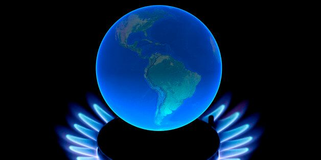 Earth globe with flames, symbol for global warming, climate change