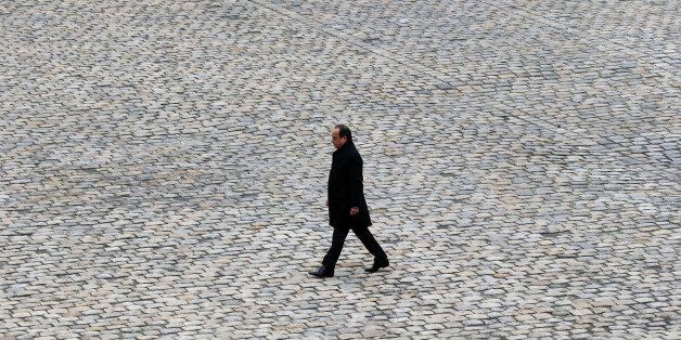 FILE - In this Friday, Nov. 27, 2015 file picture, French President Francois Hollande walks in the courtyard of the Invalides