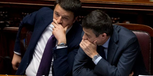 Italian premier Matteo Renzi, left, talks with Infrastructure Minister Maurizio Lupi prior to a confidence...