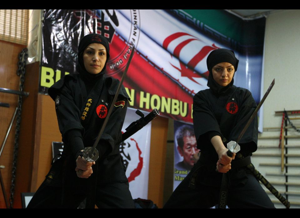 Iranian female Ninjas demonstrate Ninjutsu skills with their swords in a martial arts club during a showcase for the media in