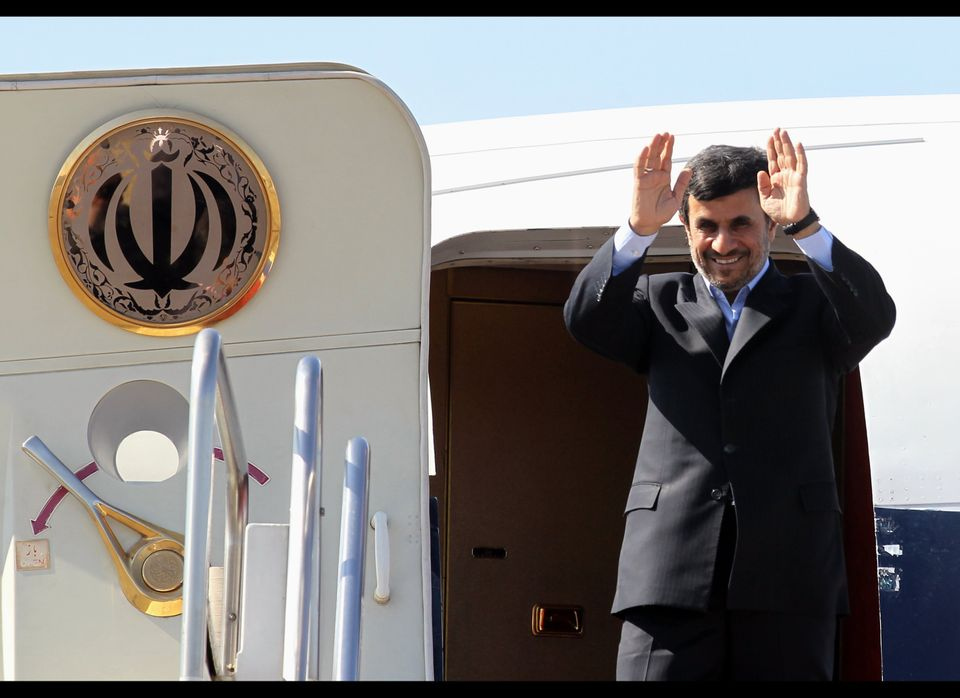 Iranian President Mahmoud Ahmadinejad waves prior to entering an airplane leaving Iran for Tajikistan at Tehran's Mehrabad ai