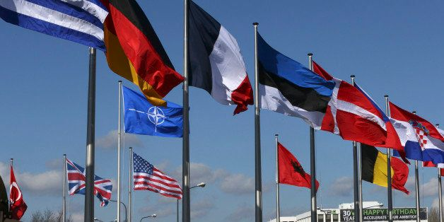 Flags fly at the Alliance headquarters in Brussels during a NATO ambassadors meeting on the situation in Ukraine and the Crim