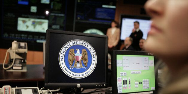 The National Security Agency (NSA) logo is shown on a computer screen inside the Threat Operations Center at the NSA in Fort
