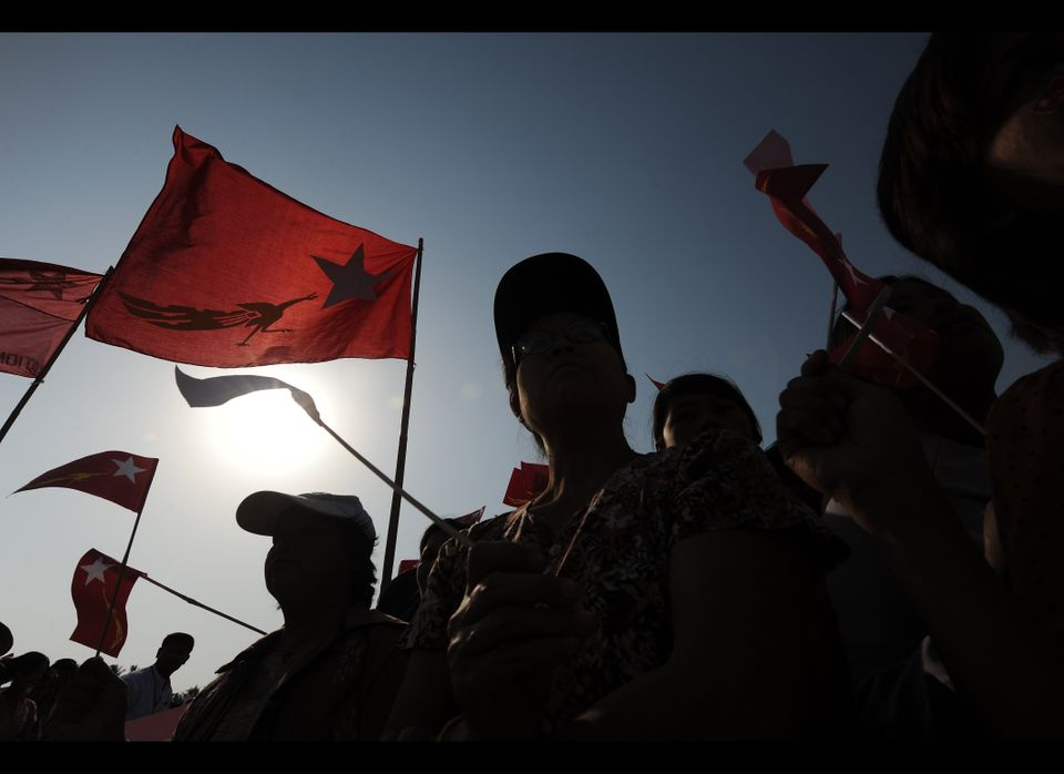 Supporters of Myanmar opposition leader Aung San Suu Kyi wait for her arrival at an electoral campaign rally in Naypyidaw on