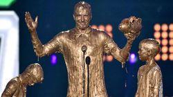 David Beckham e i figli ricoperti d'oro