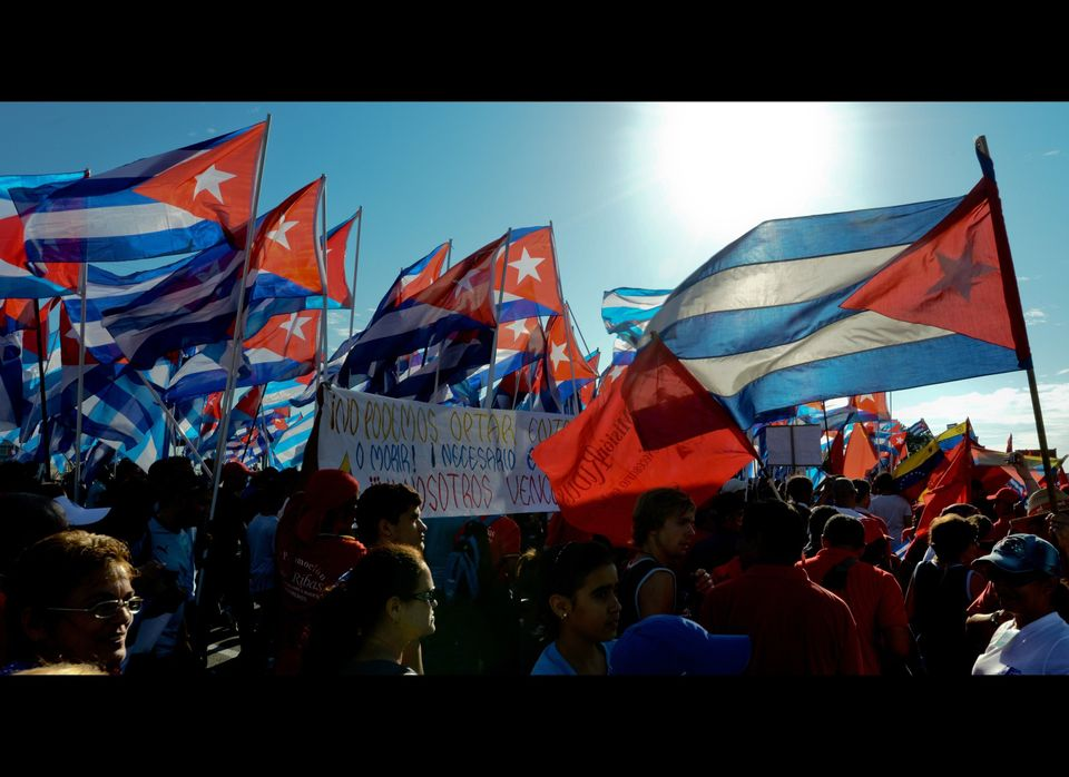 Thousands of Cubans march under the slogan 'Preserve and Perfect Socialism', at Revolution Square in Havana during Labour Day