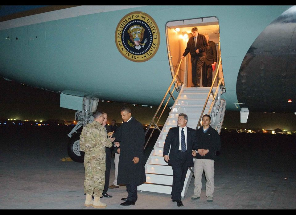 US President Barack Obama is greeted by US Lieutenant General Curtis Scaparrotti and US Ambassador to Afghanistan Ryan Crocke