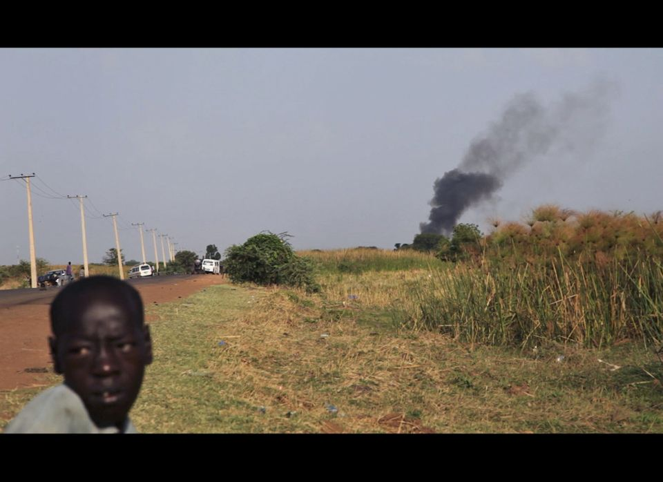 Black smoke rises from the market in Rubkona near Bentiu in South Sudan Monday, April 23, 2012. A boy was killed and at least