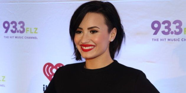 Demi Lovato attends 93.3 FLZ's Jingle Ball 2014 at Amalie Arena on Friday, Dec. 22, 2014, in Tampa, Florida....