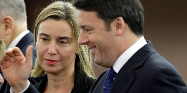 Italian Premier Matteo Renzi, right, is flanked by European Union foreign policy chief, Federica Mogherini,...