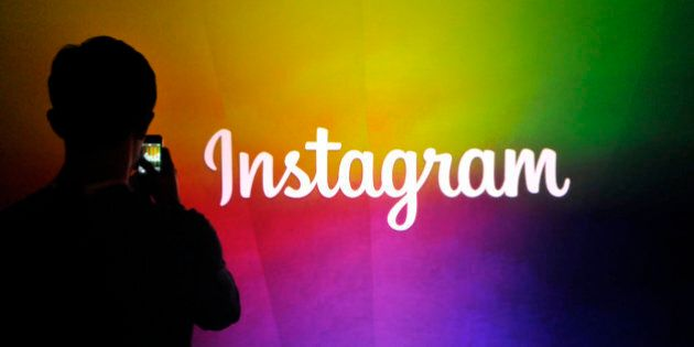 An Instagram employee takes a video using Instagram's new video function at Facebook's corporate headquarters...