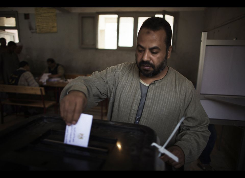 An Egyptian man casts his ballot at a polling station in the Manshiyet Nasser district in Cairo on May 23, 2012, during histo