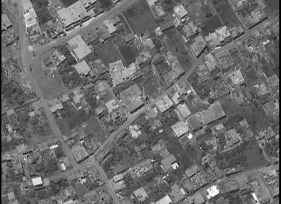 This black and white image shows the center of Taldou, on the outskirts of Houla, on Friday morning. Reports indicate that sh