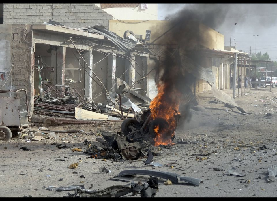 Smoke rises at the site of a car bomb in the northern Iraqi city of Kirkuk on June 13, 2012 as a wave of bombings and shootin