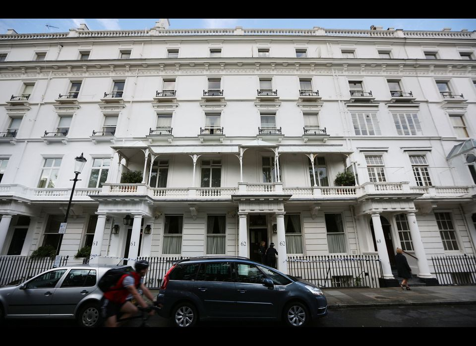 LONDON, ENGLAND - JULY 10:  Police tape lines the outside of the house of Eva Rausing in Knightsbridge on July 10, 2012 in Lo