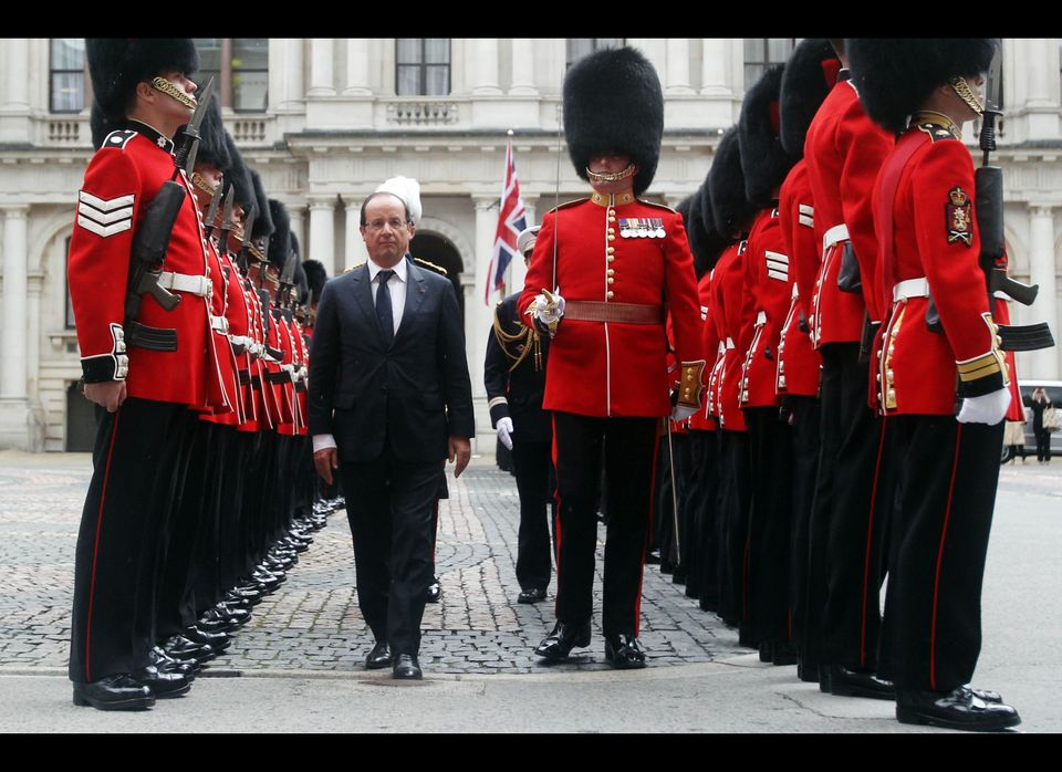 French President Francois Hollande inspects the guard of honour, 1st Battalion of the Coldstream Guards, with Major James Col