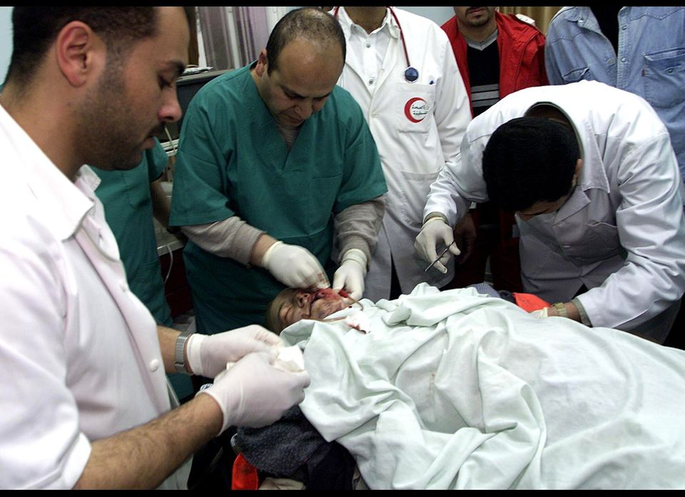 In this Sunday, March 16, 2003, photo, Palestinian doctors try to save the life of Rachel Corrie, 23, from Olympia, Wash. at