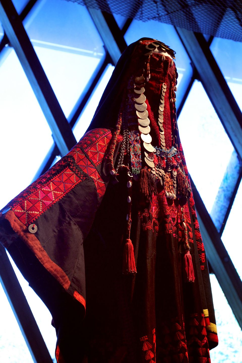 A picture taken on February 7, 2011 shows a mid 1930' Sinai Bedouin wedding costume and a head finery called burqa, one of th