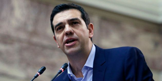 Greece's Prime Minister Alexis Tsipras delivers a speech to his party's lawmakers at the parliament in...