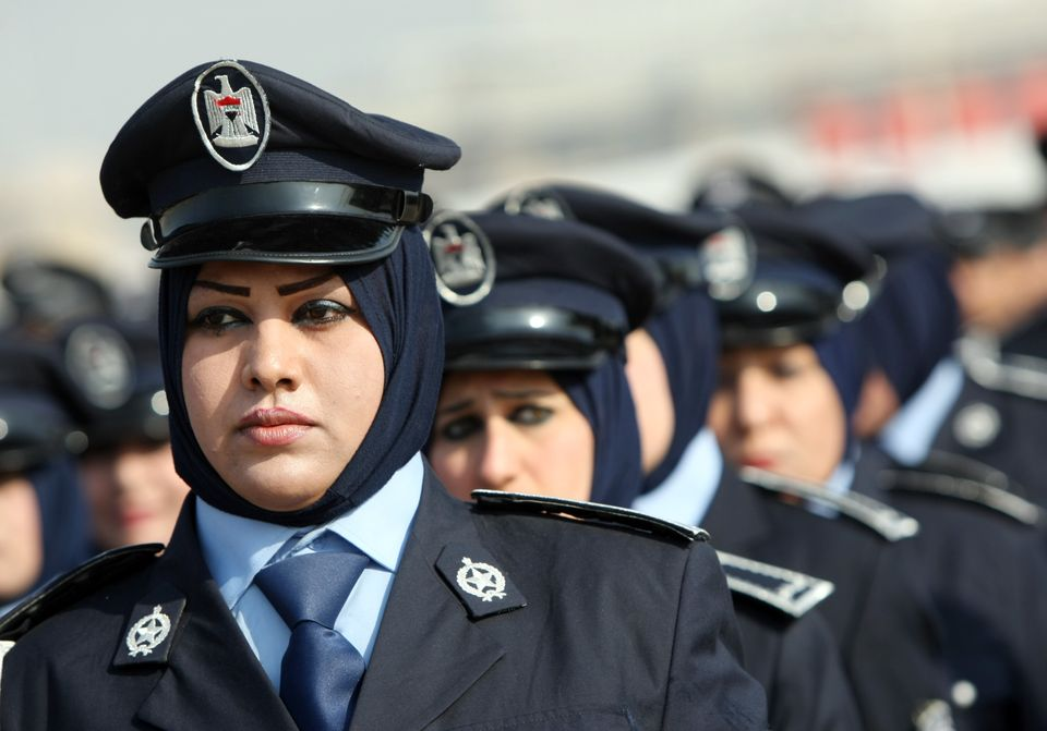 Iraqi police women march during a parade to mark 90 years since its foundation in the Iraqi capital Baghdad, on January 9, 20